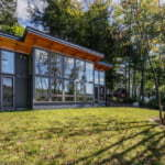 FabCab TimberCab prefab ADU with shed roof and over-sized, floor to ceiling windows.