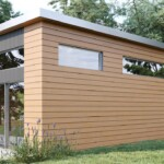 Exterior side and rear view of the Emerald modern prefab modular mini home adu by Dvele.